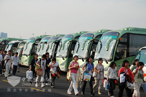 Landscape line consisting of King Long buses outside World Expo site